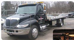 A Precision Auto Body and Transport flatbed tow truck